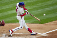 Philadelphia Phillies' Alec Bohm hits an RBI single during the first inning of a baseball game against the St. Louis Cardinals, Saturday, April 17, 2021, in Philadelphia. (AP Photo/Laurence Kesterson)