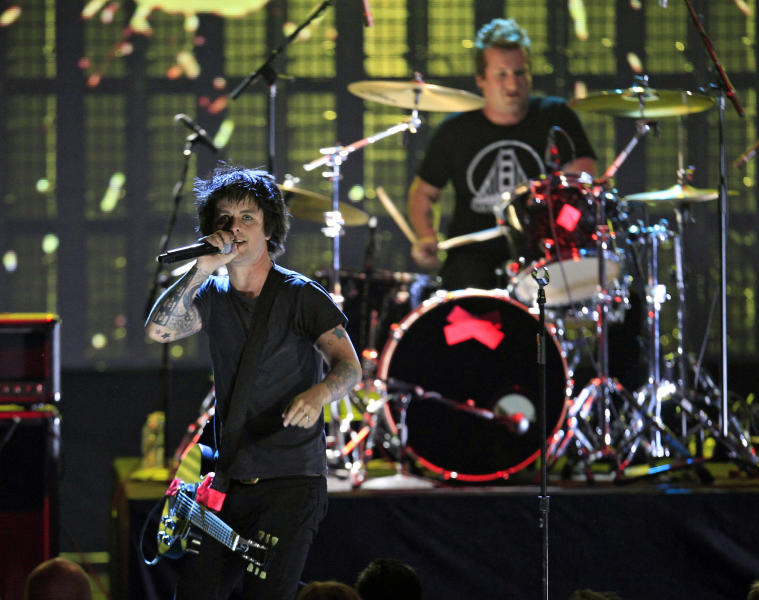 Billie Joe Armstong and drummer Tre Cool of Green Day perform to open the 2012 Rock and Roll Hall of Fame induction ceremonies Saturday, April 14, 2012, in Cleveland. Green Day introduce Guns N' Roses for induction into the Rock and Roll Hall of Fame. (AP Photo/Tony Dejak)