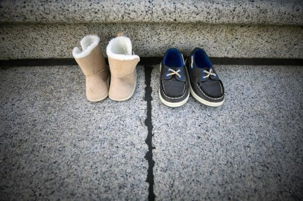 Shoes are placed on the front steps of the B.C. legislature on May 31, 2021 in memory of the children who died at the former Kamloops Indian Residential School.  (Mike McArthur/CBC - image credit)