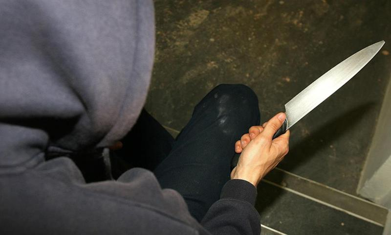 Young person with knife