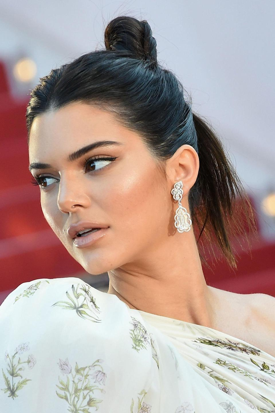 <p>At the <em>120 Beats Per Minute</em> premiere Jenner balanced classic make-up with a modern up-do, wearing her hair in an imperfectly perfect knot.</p>