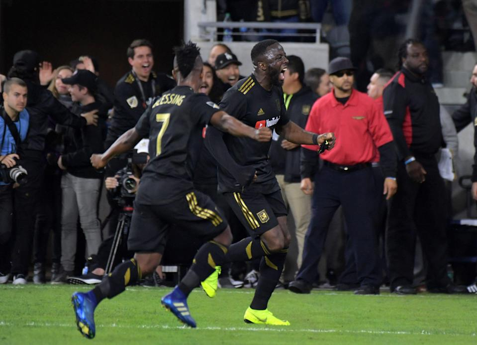 Mar 3, 2019; Los Angeles, CA, USA; LAFC forward Adama Diomande (99) celebrates with forward Latif Blessing (7) after scoring the winning goal in stoppage time against Sporting KC at Banc of California Stadium. LAFC defeated SKC 2-1. Mandatory Credit: Kirby Lee-USA TODAY Sports