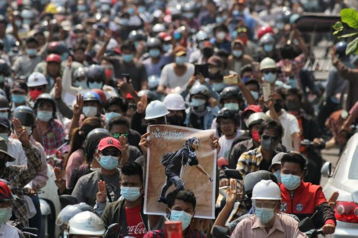 People attend the funeral of Angel a 19-year-old protester also known as Kyal Sin who was shot in the head as Myanmar forces opened fire to disperse an anti-coup demonstration in Mandalay