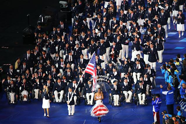 LONDON, ENGLAND - AUGUST 29: Athlete Scott Danberg of United States carries the flag during the Opening Ceremony of the London 2012 Paralympics at the Olympic Stadium on August 29, 2012 in London, England. (Photo by Mike Ehrmann/Getty Images)