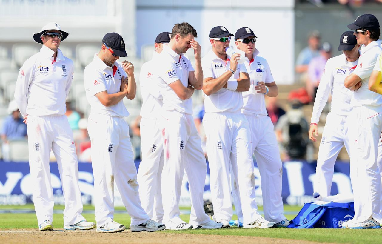 England's James Anderson (centre) shows his dejection after a failed review for the wicket of Australia's Steve Smith, during day one of the Third Investec Ashes test match at Old Trafford Cricket Ground, Manchester.