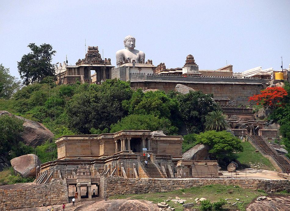 The statue of Lord Bahubali on Vindhyagiri hill overlooks Vadegal Basadi in the foreground.