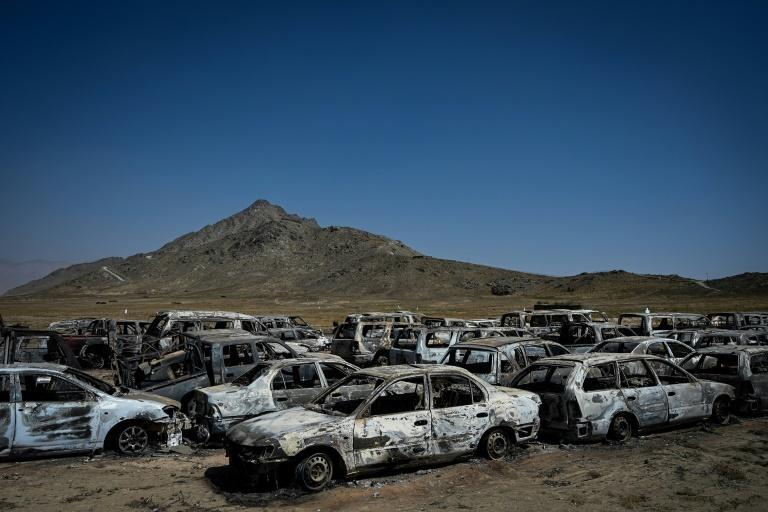 The parking lot is packed with the incinerated wrecks of scores of vehicles (AFP/Aamir QURESHI)