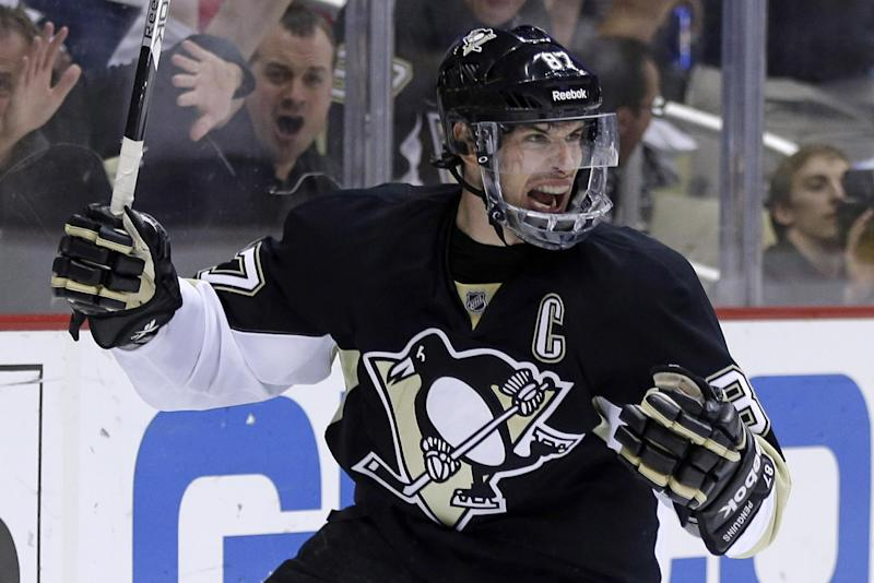 Pittsburgh Penguins' Sidney Crosby (87) celebrates after scoring during the second period of Game 5 of an NHL hockey Stanley Cup first-round playoff series against the New York Islanders, Thursday, May 9, 2013, in Pittsburgh. (AP Photo/Gene J. Puskar)