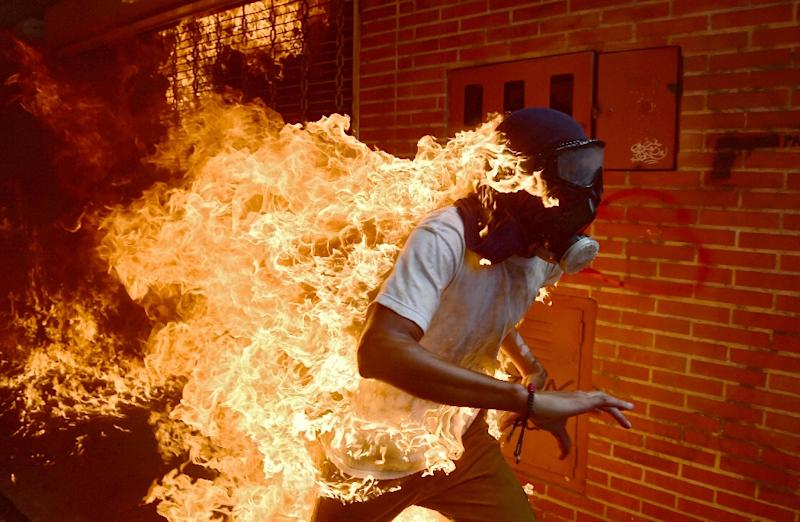 A demonstrator catches fire during clashes with riot police within a protest against Venezuelan President Nicolas Maduro, in Caracas on May 3, 2017