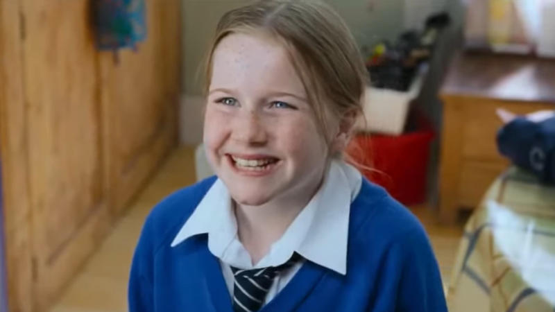 Lulu Popplewell as Daisy, daughter of Emma Thompson's character, in the 2003 Christmas classic 'Love Actually'. (Credit: Universal)