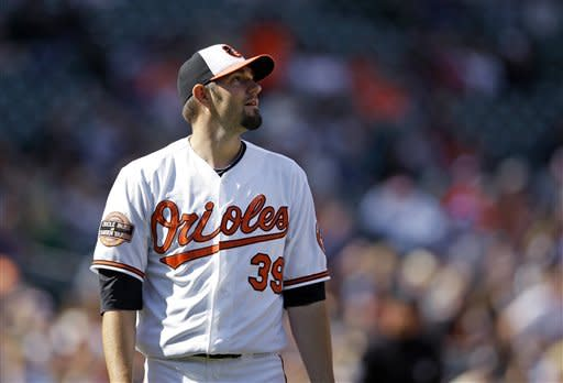 Baltimore Orioles starting pitcher Jason Hammel watches a hit by Minnesota Twins' Justin Morneau to right field in the eighth inning of a baseball game in Baltimore, Sunday, April 8, 2012. Morneau's hit was the first that Hammel gave up in the game. Baltimore won 3-1. (AP Photo/Patrick Semansky)