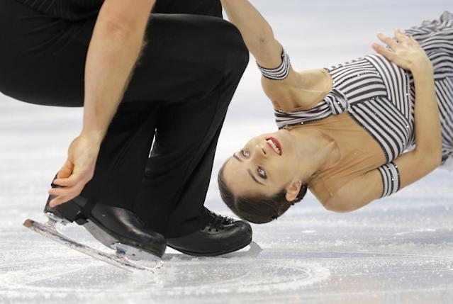 Vera Bazarova and Yuri Larionov of Russia compete in the pairs short program figure skating competition at the Iceberg Skating Palace during the 2014 Winter Olympics, Tuesday, Feb. 11, 2014, in Sochi, Russia. (AP Photo/Vadim Ghirda)