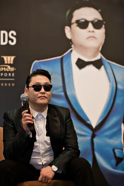 Psy appeared to be stoic during a press conference before the concert. (Yahoo! photo)