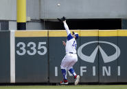 Atlanta Braves' Adam Duvall catches a ball hit by Milwaukee Brewers' Jackie Bradley Jr. in the third inning of a baseball game Sunday, Aug. 1, 2021, in Atlanta. (AP Photo/Ben Margot)