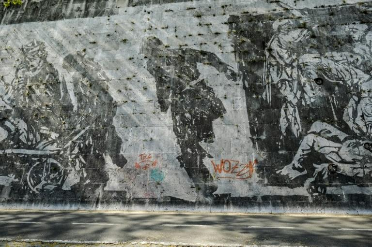 """Graffiti was scrawled on the """"Triumphs and Laments"""" fresco which was completed along the banks of Rome's Tiber river less than a year ago by South African artist William Kentridge"""