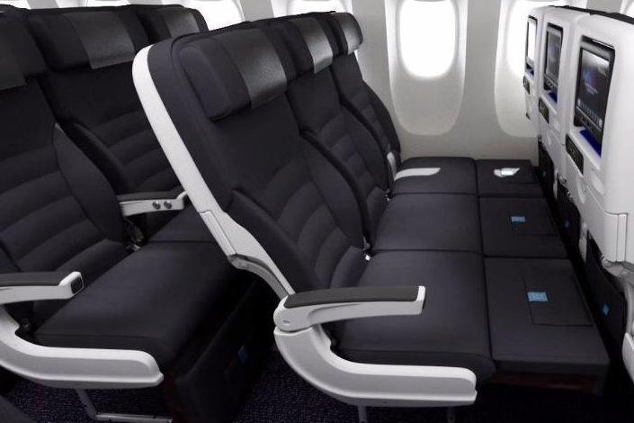 Air New Zealand's Skycouch allows for a row of three economy seats to be converted into a flat bed (Air New Zealand)