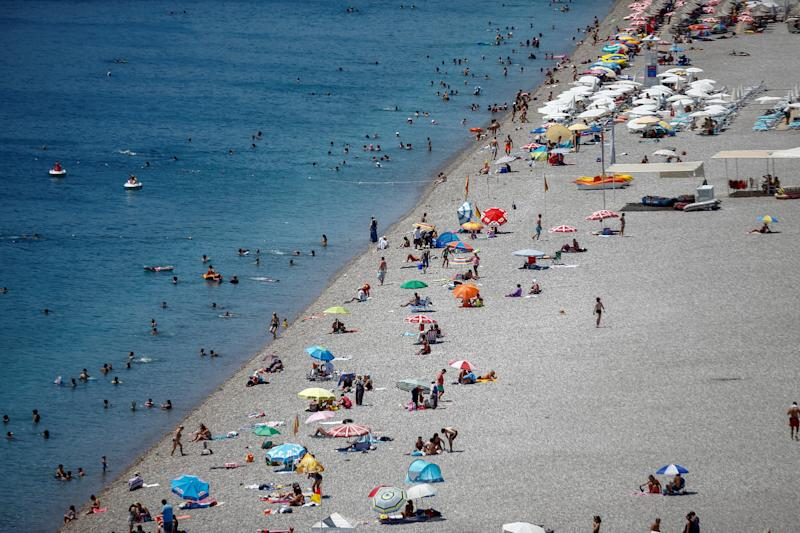 ANTALYA, TURKEY - AUGUST 7 : An aerial view of people enjoying the sea at Konyaalti Beach in Antalya, Turkey on August 7, 2019. Antalya's weather temperature reached 37 degrees Celsius while water temperature was 30 degrees Celsius. (Photo by Mustafa Ciftci/Anadolu Agency via Getty Images)