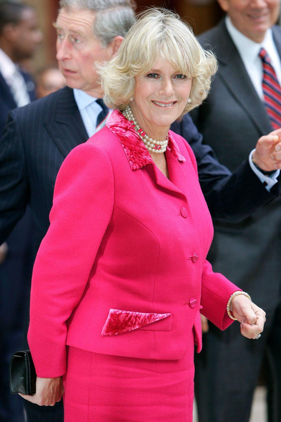 <p>Camilla didn't shy away from a major pink moment, combining her hot pink suit with fuchsia gems for a visit to the British Memorial Garden in New York City in 2005.</p>