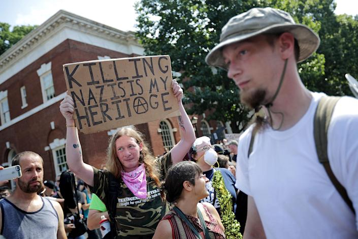 <p>Counter-protesters line the route taken by white nationalists, neo-Nazis and members of the 'alt-right' during the 'Unite the Right' rally August 12, 2017 in Charlottesville, Virginia. After clashes with anti-fascist protesters and police the rally was declared an unlawful gathering and people were forced out of Lee Park, where a statue of Confederate General Robert E. Lee is slated to be removed. (Photo: Chip Somodevilla/Getty Images) </p>
