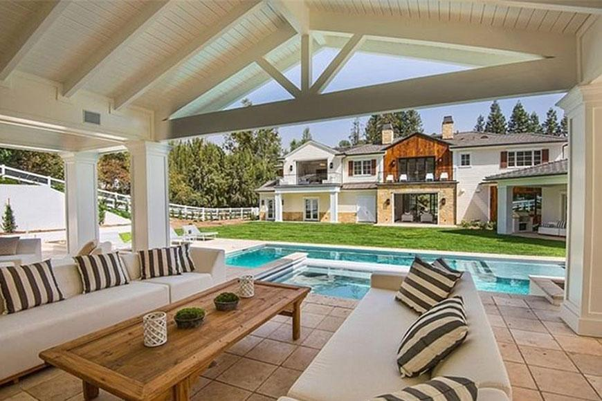"""The """"Starboy"""" singer reportedly purchased the sprawling estate for a cool $24 million US (over $31 million AUD), and the luxury home features nine bedrooms, 11 baths, a resort style saltwater pool, wine cellar, eight-stall barn and a 1,200 square foot guesthouse."""