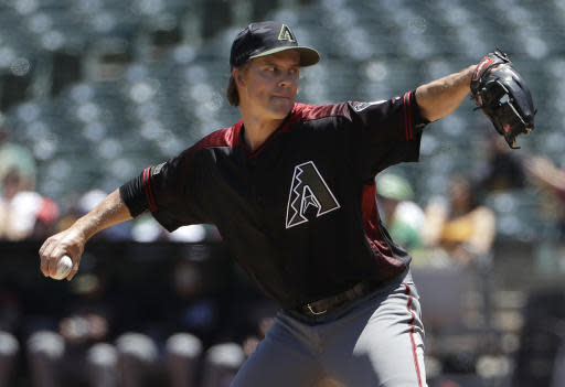 Arizona Diamondbacks pitcher Zack Greinke throws against the Oakland Athletics during the first inning of a baseball game in Oakland, Calif., Sunday, May 27, 2018. (AP Photo/Jeff Chiu)