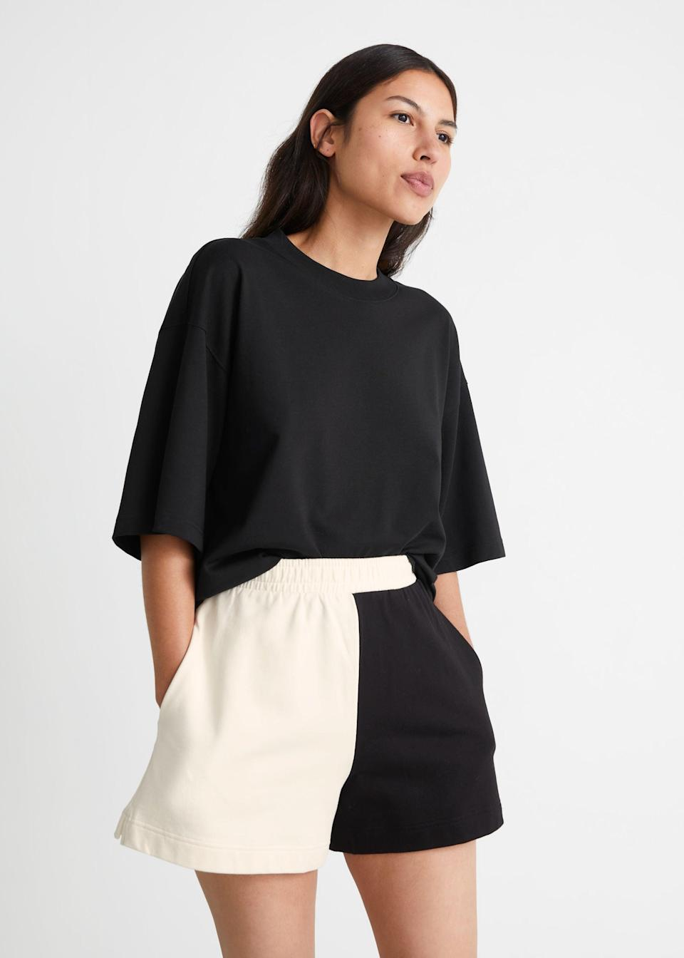 """I'm not much of a skirt person but shorts I can definitely do. I love this laid-back and floaty, two-tone pair, which I'd team with an oversized tee, lots of gold jewellery and chunky sandals.<br><br><strong>& Other Stories</strong> Two-Tone Terry Shorts, $, available at <a href=""""https://www.stories.com/en_gbp/clothing/shorts/product.two-tone-terry-shorts-black.1011739001.html"""" rel=""""nofollow noopener"""" target=""""_blank"""" data-ylk=""""slk:& Other Stories"""" class=""""link rapid-noclick-resp"""">& Other Stories</a>"""