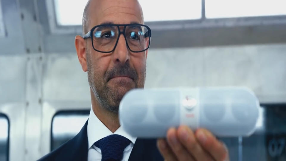 Stanley Tucci turns Beats marketing man in 'Transformers: Age of Extinction'. (Credit: Paramount)