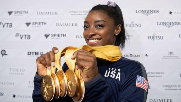 PHOTO: Simone Biles of the United States shows her five gold medals at the Gymnastics World Championships in Stuttgart, Germany, Oct. 13, 2019. (Marijan Murat/dpa via AP)