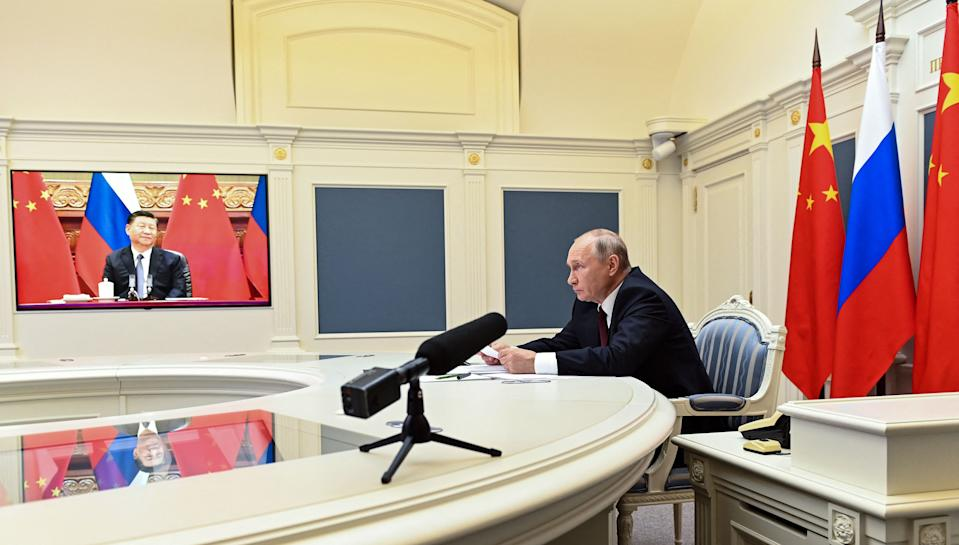 Russian President Vladimir Putin holds a meeting via video conference with Chinese President Xi Jinping at the Kremlin in Moscow on June 28, 2021. (Photo by Alexey NIKOLSKY / Sputnik / AFP) (Photo by ALEXEY NIKOLSKY/Sputnik/AFP via Getty Images)