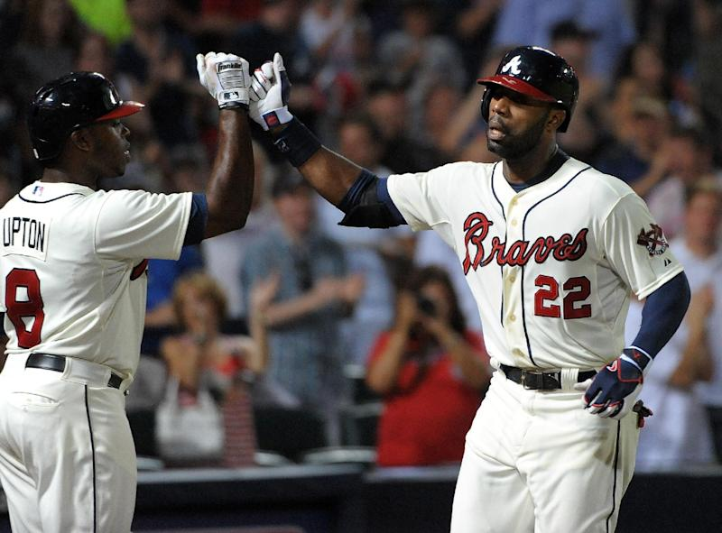 Atlanta Braves' Jason Heyward (22) is congratulated by teammate Justin Upton after Heyward's solo home run against the St. Louis Cardinals during the third inning of a baseball game at Turner Field, Sunday, July 28, 2013, in Atlanta. (AP Photo/David Tulis)