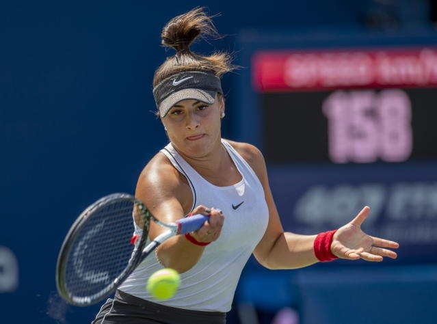 Bianca Andreescu, of Canada, hits a forehand to Sofia Kenin, of the United States during the Rogers Cup womens tennis tournament Saturday, Aug. 10, 2019, in Toronto. (Frank Gunn/The Canadian Press via AP)