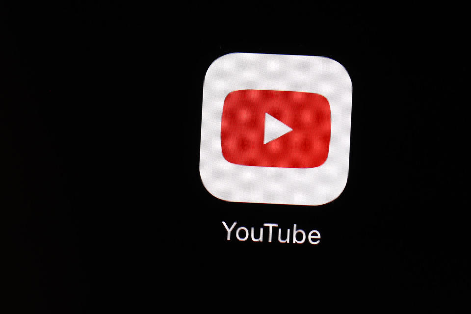 FILE - This March 20, 2018 file photo shows the YouTube app on an iPad in Baltimore. YouTube is following the lead of Twitter and Facebook, saying that it is taking more steps to limit QAnon and other baseless conspiracy theories that can lead to real-world violence. The Google-owned video platform said Thursday, Oct. 15, 2020 it will now prohibit material targeting a person or group with conspiracy theories that have been used to justify violence. (AP Photo/Patrick Semansky, File)