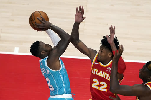Charlotte Hornets guard Terry Rozier (3) shoots as Atlanta Hawks forward Cam Reddish (22) defends during the first half of an NBA basketball game Wednesday, Jan. 6, 2021, in Atlanta. (AP Photo/John Bazemore)