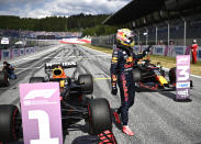 Red Bull driver Max Verstappen of the Netherlands waves in the winners circle after he placed first to take pole position during the qualifying session ahead of the Austrian Formula One Grand Prix at the Red Bull Ring racetrack in Spielberg, Austria, Saturday, July 3, 2021. The Austrian Grand Prix will be held on Sunday. (Christian Bruna/Pool Photo via AP)