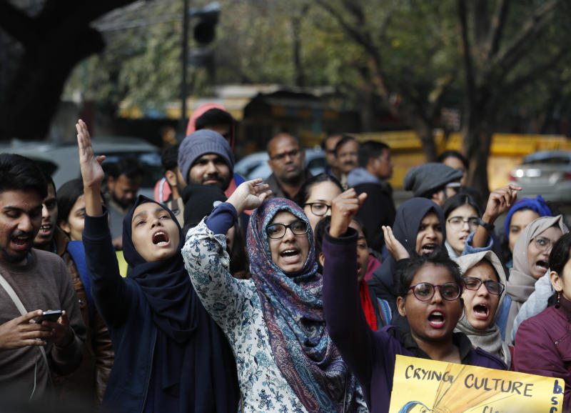 Indian students of the Jamia Millia Islamia University and others shout slogans during a protest demonstration against a new citizenship law in New Delhi, India in New Delhi, India, Tuesday, Jan. 14, 2020. The new citizenship law and a proposed National Register of Citizens have brought thousands of protesters out in the streets in many cities and towns since Parliament approved the measure on Dec. 11, leaving more than 20 dead in clashes between security forces and the protesters. (AP Photo/Manish Swarup)