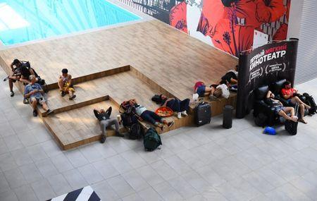 A group of Mexico football fans sleep inside a shopping mall in Samara, Russia, July 3, 2018. REUTERS/Dylan Martinez