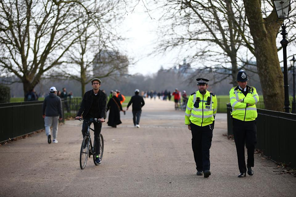 Met police officers patrol as people exercise in Hyde Park during the winter lockdown (Getty Images)