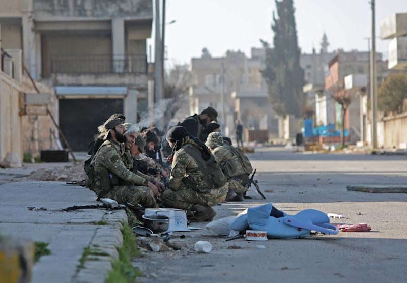 Image: Turkey-backed Syrian fighters rest in the town of Saraqib in Syria's Idlib province (Bakr Alkasem / AFP - Getty Images)