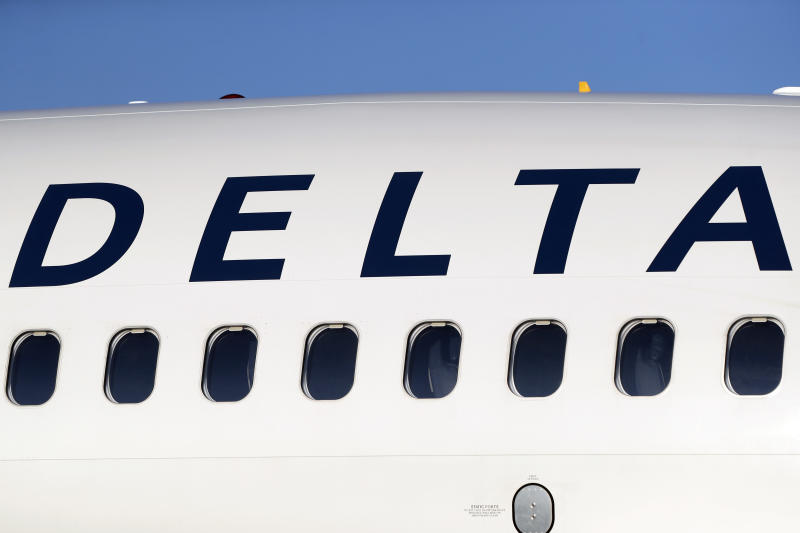FILE - In this June 26, 2019, file photo, the company logo graces the side of a Delta Air Lines jetliner at Denver International Airport in Denver. Delta Air Lines, Inc. reports earnings Wednesday, July 10. (AP Photo/David Zalubowski, File)