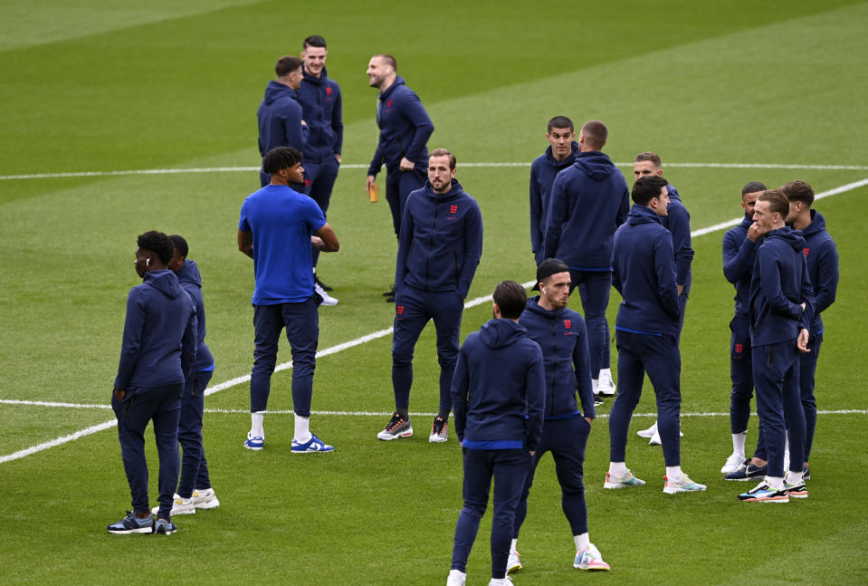 England's Harry Kane, center, walks with teammates on the field before the Euro 2020 final soccer match between Italy and England at Wembley stadium in London, Sunday, July 11, 2021. (Facundo Arrizabalaga/Pool via AP)