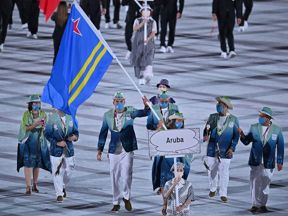 Athletes from Aruba make their entrance at the Summer Olympics.