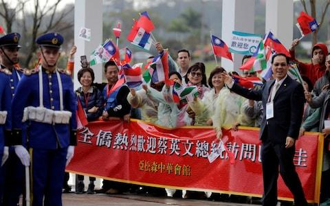 Members of the Taiwanese community in Paraguay greet President Tsai during a visit last week - Credit: Jorge Adorno/Reuters