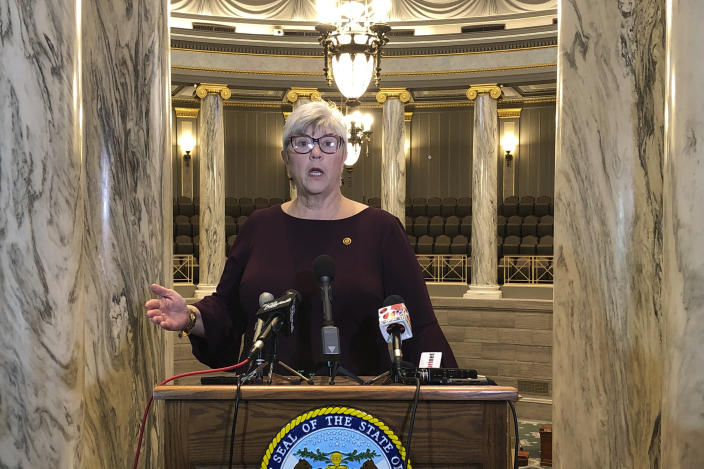 In this Jan. 9, 2019, photo, Missouri state Sen. Gina Walsh speaks to reporters from the gallery of the state Senate in Jefferson City, Mo., on the opening day of the 2019 legislative session. Walsh is among numerous lawmakers nationwide who decided to stay at home instead of attend in-person legislative sessions in April 2020 because of concerns about the coronavirus. (AP Photo/David A. Lieb)