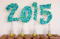 """<p>Another way to pay homage to the year is with this tissue paper DIY. Luckily, it's easy to bring to life.</p><p><strong>See the tutorial at </strong><a href=""""https://sugarbeecrafts.com/huge-tissue-paper-party-sign"""" rel=""""nofollow noopener"""" target=""""_blank"""" data-ylk=""""slk:Sugar Bee Crafts"""" class=""""link rapid-noclick-resp""""><strong>Sugar Bee Crafts</strong></a><strong>.</strong></p><p><a class=""""link rapid-noclick-resp"""" href=""""https://www.amazon.com/Flexicore-Packging®-Gift-Tissue-Paper/dp/B07PHK5X55/?tag=syn-yahoo-20&ascsubtag=%5Bartid%7C10050.g.31121022%5Bsrc%7Cyahoo-us"""" rel=""""nofollow noopener"""" target=""""_blank"""" data-ylk=""""slk:SHOP BLUE TISSUE PAPER""""><strong>SHOP BLUE TISSUE PAPER</strong></a></p>"""
