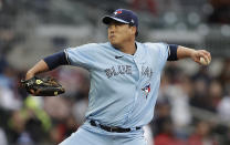 Toronto Blue Jays pitcher Hyun Jin Ryu works against the Atlanta Braves during the first inning of a baseball game Wednesday, May 12, 2021, in Atlanta. (AP Photo/Ben Margot)
