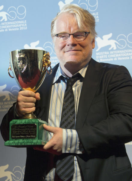 Actor Philip Seymour Hoffman with the Coppa Volpi for best actor for himself and Joaquin Phoenix for their roles in the film 'The Master' at the awards photo call during the 69th edition of the Venice Film Festival in Venice, Italy, Saturday, Sept. 8, 2012. (AP Photo/Joel Ryan)
