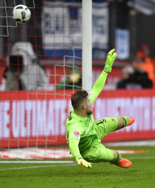 Cologne goalkeeper Timo Horn receives a penalty goal during the German Bundesliga soccer match between 1.FC Cologne and Hertha BSC Berlin in Cologne, Germany, Saturday, March 18, 2017. (AP Photo/Martin Meissner)