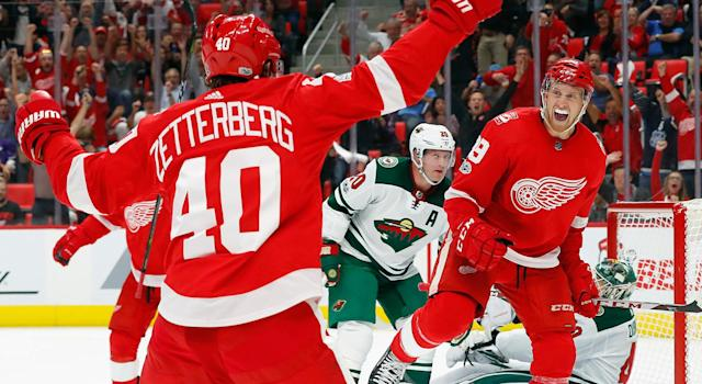 """<a class=""""link rapid-noclick-resp"""" href=""""/nhl/teams/det/"""" data-ylk=""""slk:Detroit Red Wings"""">Detroit Red Wings</a> forward <a class=""""link rapid-noclick-resp"""" href=""""/nhl/players/5999/"""" data-ylk=""""slk:Anthony Mantha"""">Anthony Mantha</a> scored the first goal in the history of Little Caesars Arena on Thursday night. (AP Photo/Paul Sancya)"""