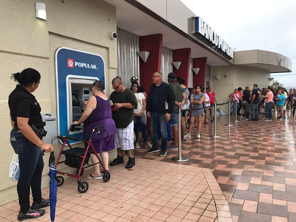 Residents of Ponce, Puerto Rico, line up at an ATM in hopes of getting some cash. More than a week after Hurricane Maria struck, residents are waiting in long lines to withdraw money and for gasoline