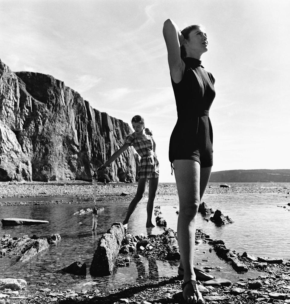 <p>Sabine and Janet Stevenson model Claire McCardell swimsuits on the Gaspé Peninsula of Canada.</p>